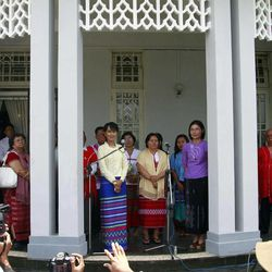 Myanmar's pro-democracy leader Aung San Suu Kyi, center left, speaks during a press conference after meeting with representatives of the Karen National Union (KNU) at her lakeside residence Sunday, April 8, 2012, in Yangon, Myanmar.