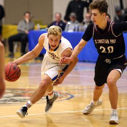 Orem's Shawn Anderson dribbles past the British Columbia Christian Panthers' Emir Krupic during a Vivint Great Western Shootout basketball game at Orem High School in Orem on Friday, Dec. 8, 2017. Orem won 63-56.