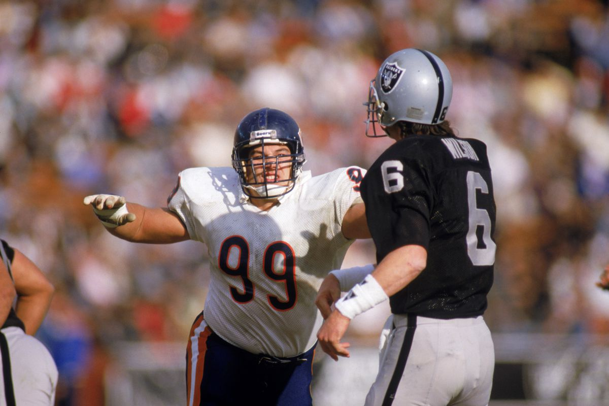 eee4144e5dd Defensive tackle Dan Hampton #99 of the Chicago Bears rushes after  quarterback Marc Wilson #6 of the Los Angeles Raiders during a game in 1986  at Los ...