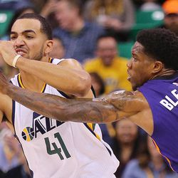 Utah Jazz forward Trey Lyles (41) just about has the ball stolen by Phoenix Suns guard Eric Bledsoe (2) as the Jazz and Suns play in Salt Lake City at Vivint Smart home arena on Wednesday, Oct. 12, 2016.