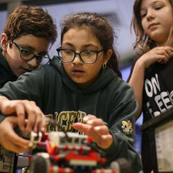 Miguel Fregoso, left, Paloma Velazquez, middle, and Emma Hopper, right, build robots out of Lego blocks during a Lego Camp at Zaniac Learning in Salt Lake City on Monday, Feb. 20, 2017.