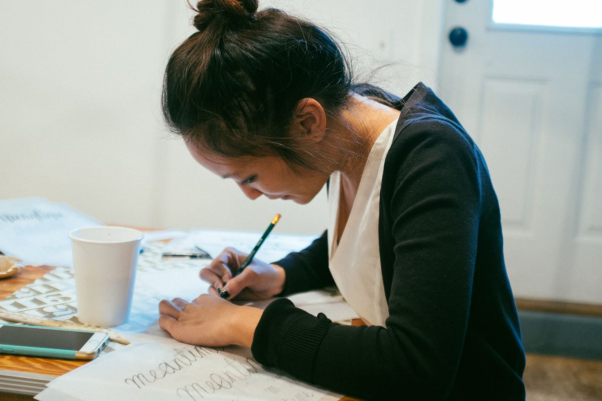 Sharon Wong working on some letters.