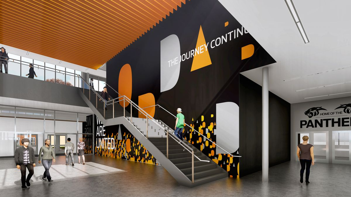 Interior of school with modern design, with orange white and black graphic designs on the wall