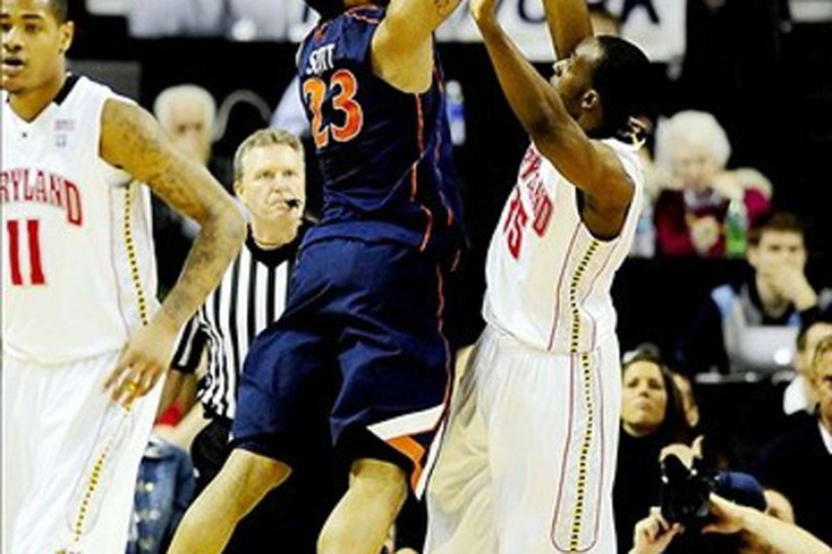 March 4, 2012; College Park, MD, USA; Virginia Cavaliers forward Mike Scott (23) shoots the ball over Maryland Terrapins forward James Padgett (35) at Comcast Center. Mandatory Credit: Evan Habeeb-US PRESSWIRE