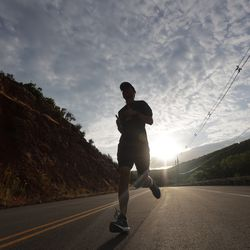 A runner participates in the Deseret News Half Marathon in Emigration Canyon in Salt Lake City on Friday, July 23, 2021