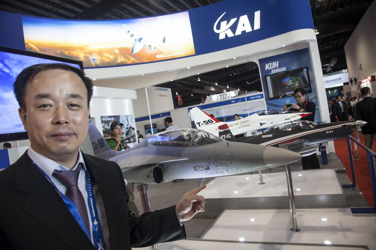 A man touch model of FA-50 by Korea Aerospace Industries is displayed at the Singapore Airshow on February 13, 2014 in Singapore.