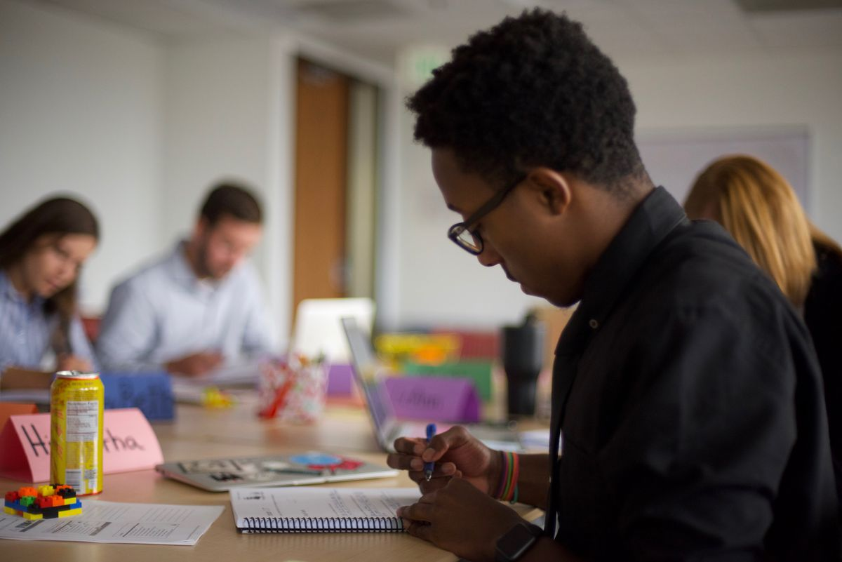 Hiawatha Davis III, a Teach For America corps members, works on an assignment at a recent training at the organization's Denver office.