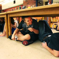 Justin Hatfield, right, and Zachary Smith, Taylorsville High School students in Steve Woolley's physics class, joke with each other during an earthquake drill, Tuesday, April 17, 2012.