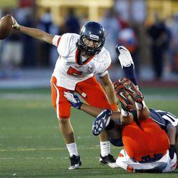 Mountain Crest's #5 Jamison Webb scrambles to avoid the rush just before half time Friday, Aug. 31, 2012.