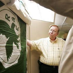 Ron Fox searches for Utah's first state flag last August. Fox's search ended six months later, when a Utah State Historical Society Museum staff member uncovered it.