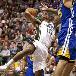Jazz guard Alec Burks (10) takes an off-balance shot during the first half of the NBA basketball game between the Utah Jazz and the Golden State Warriors at Energy Solutions Arena, Wednesday, Dec. 26, 2012.