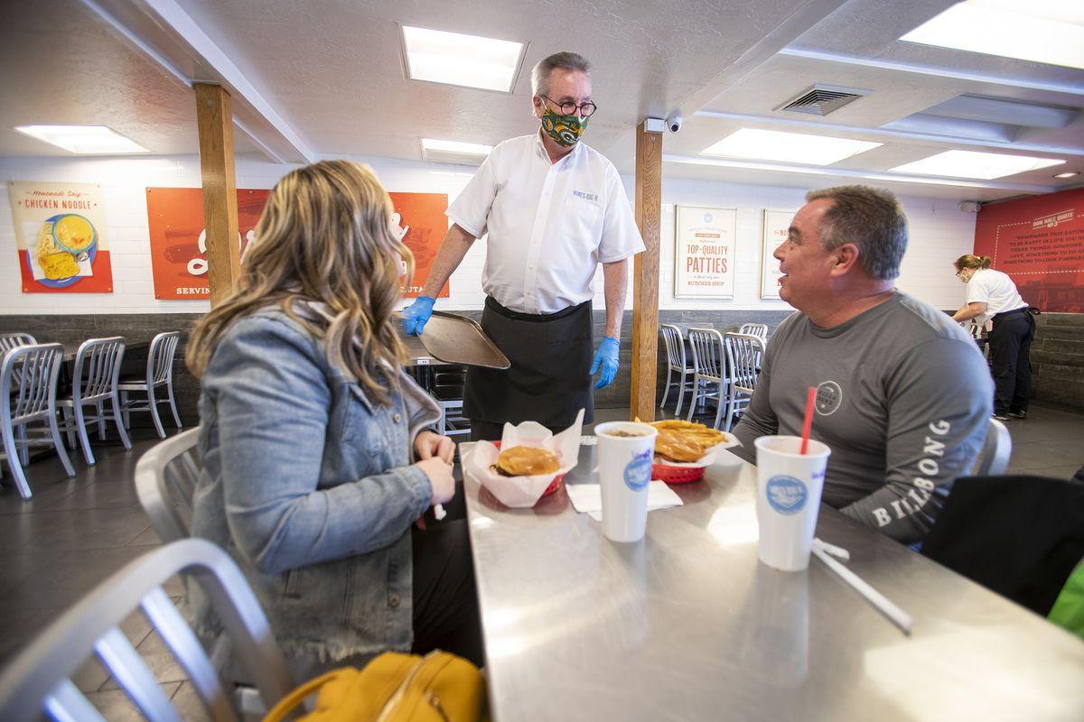 Longtime Hires Big H employee Jim Merrill talks with longtime customers Marci and Shawn Nordhoff as he works his last week of shifts at the burger joint in Salt Lake City on Friday, Jan. 8, 2021. Merrill has worked at the company for 52 years.