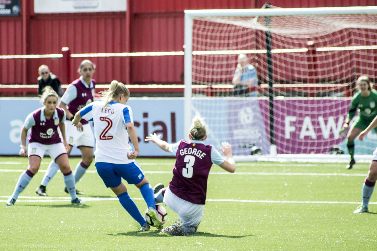 Photo of AVLFC's Hannah George vies for the ball with BHAFC's Jenna Legg.