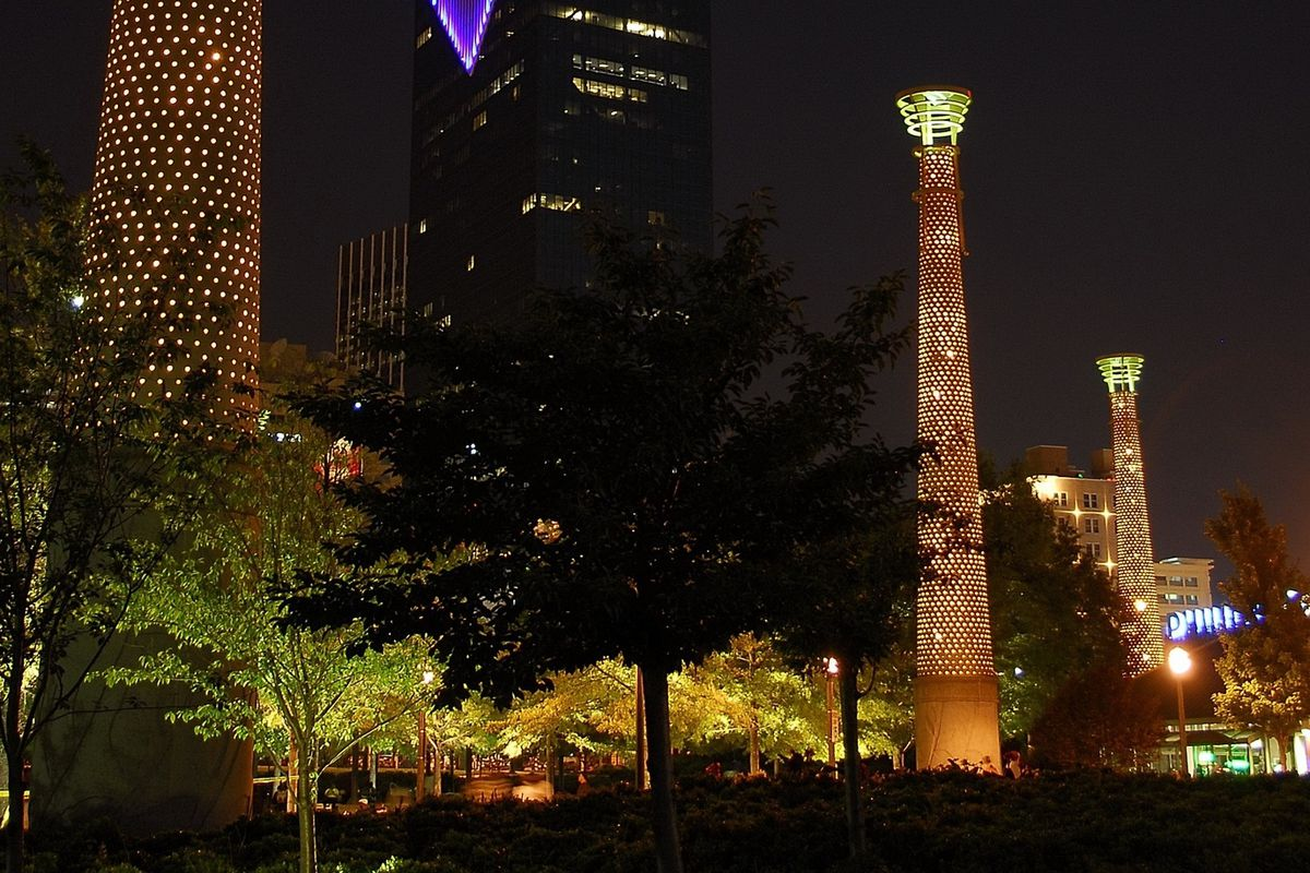 A photo of Centennial Olympic Park's light towers, as designed by Turner Associates/Oscar Harris FAIA for Atlanta's 1996 Olympics.