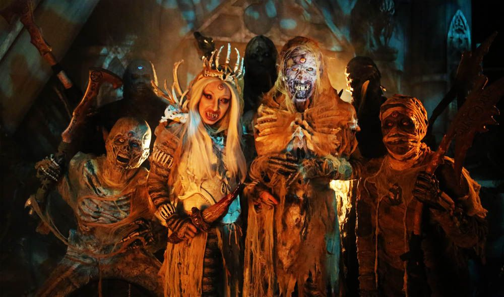 Zombies and monsters in Halloween attire,