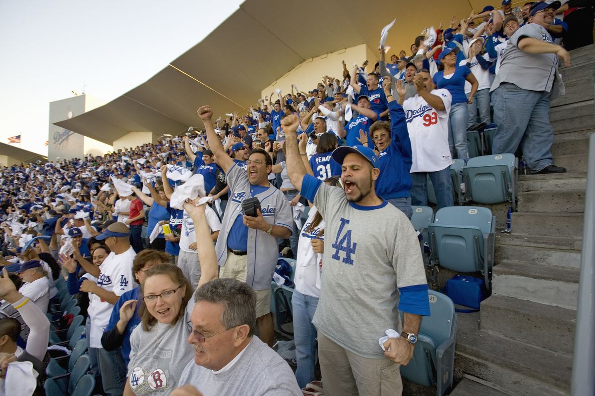 Dodger fans cheering during National League Championship Series (NLCS), Dodger Stadium, Los Angeles, CA on October 12, 2008.