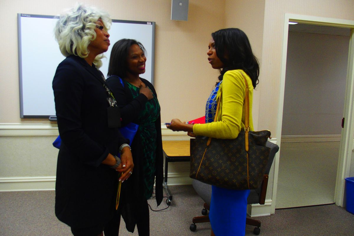 From left: Sharon Griffin, regional superintendent of the Innovation Zone in Memphis, speaks with iZone adviser Ashleigh Dennis and Kameelah Shaheed-Diallo, a vice president with The Mind Trust, a nonprofit education organization based in Indianapolis.