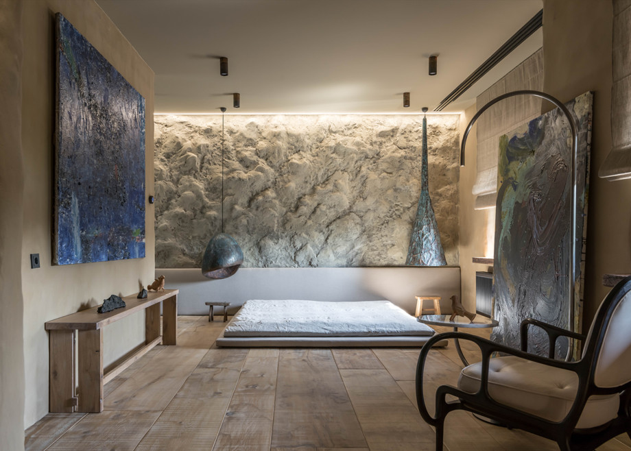 Room with textured wall and tatami bed.