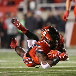 Utah Utes running back Devonta'e Henry-Cole (7) trips and falls on a run during the game against the Colorado Buffaloes at Rice-Eccles Stadium in Salt Lake City on Saturday, Nov. 25, 2017.