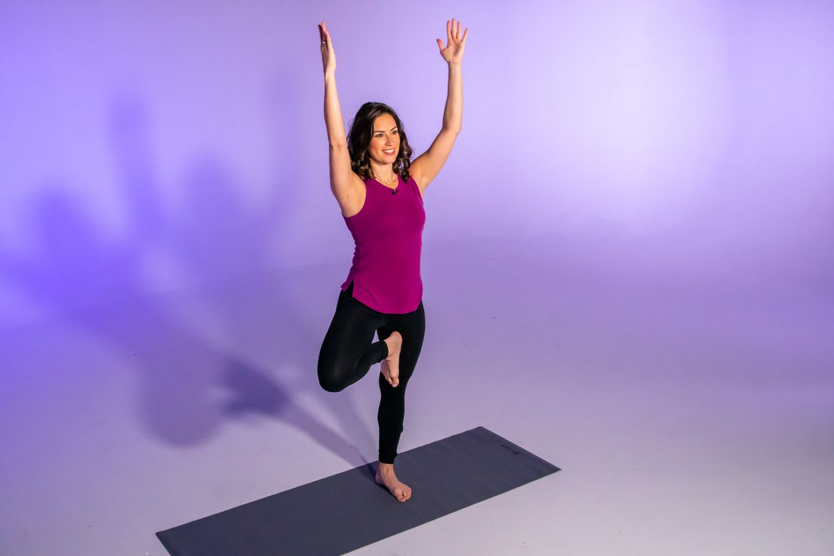 Stephanie Mansour demonstrates a horse or goddess pose with an added reach, which is part of her centering yoga workout.