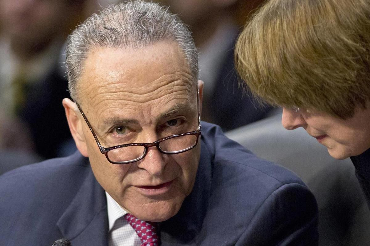 FILE – In this May 9, 2013, file photo Sen. Chuck Schumer, D-N.Y., left, confers with Sen. Amy Klobuchar, D-Minn., as the Senate Judiciary Committee meets on immigration reform on Capitol Hill in Washington. The Senate is on the cusp of approving historic