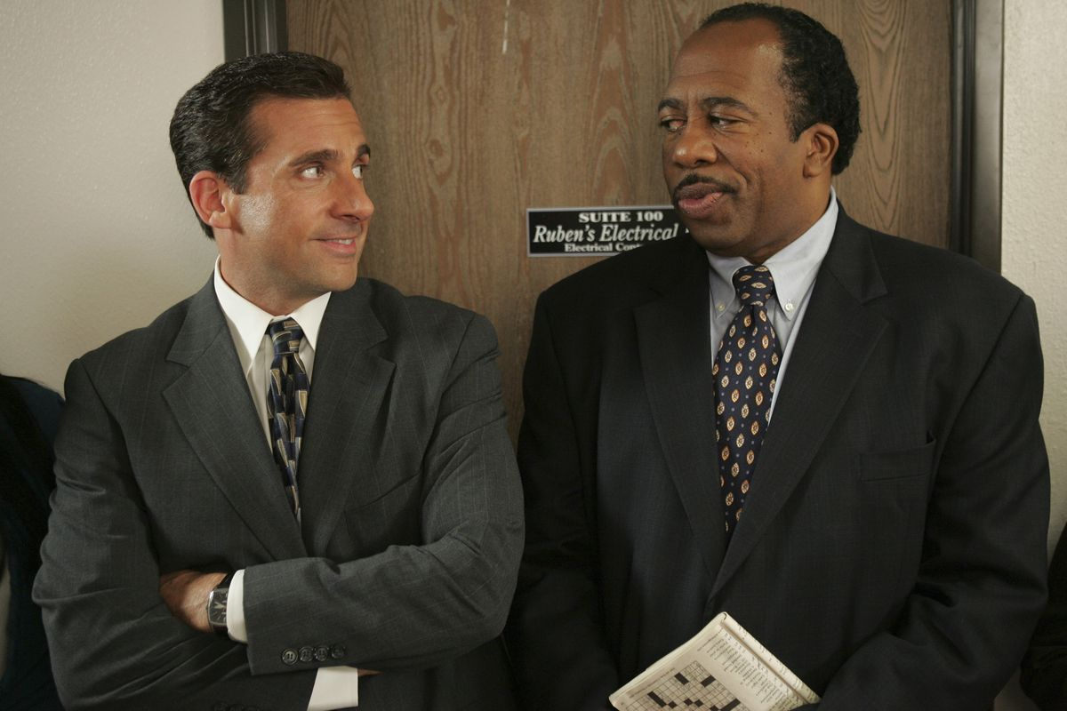 the office: michael scott and stanley hudson stand in front of an office