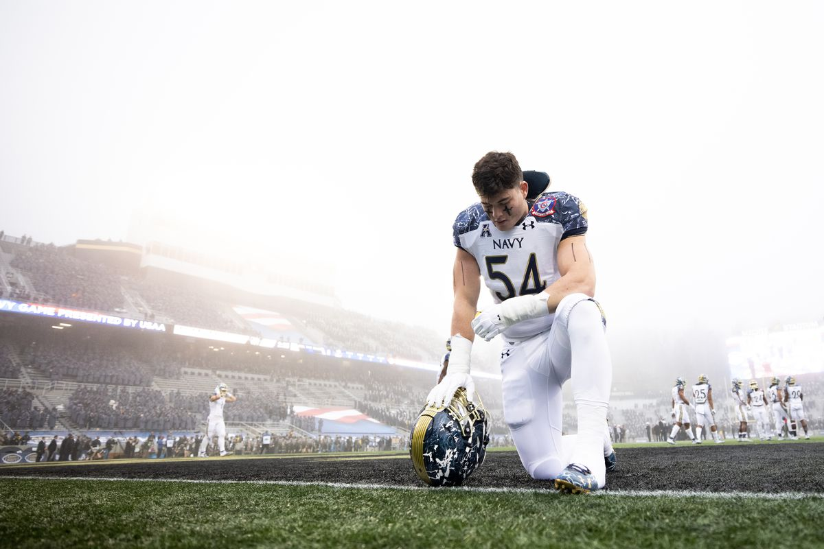 Diego Fagot of the Navy Midshipmen kneels in the end zone before the start of a game against the Army Black Knights at Michie Stadium on December 12, 2020 in West Point, New York.
