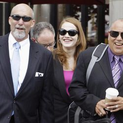 """FILE - In this July 31, 2012 file photo, defense attorneys from left, Joel Brodsky, Lisa Lopez, and Joe Lopez return to the Will County Courthouse in Joliet, Ill., from a break after giving opening statements in the murder case of former Bolingbrook, Ill., police officer Drew Peterson, who is charged in the 2004 death of his third wife, Kathleen Savio. For more than month, the jurors at Peterson's trial have caused a stir by been coming into court wearing matching clothes _ all yellow one day; other days black, blue and green. They've even filed in wearing alternating red, white and blue. And the coordinated attire hasn't been just about color. Once, it was all business suits. Then there was the day they all wore jerseys from sports teams _ mostly Bears and White Sox, though one was a Green Bay Packers shirt, and none for the Cubs. """"If they came in wearing T-shirts saying 'Drew's Guilty,' it'd be different,"""" said Lisa Lopez. """"I think it means they are unified about coming to a decision."""""""