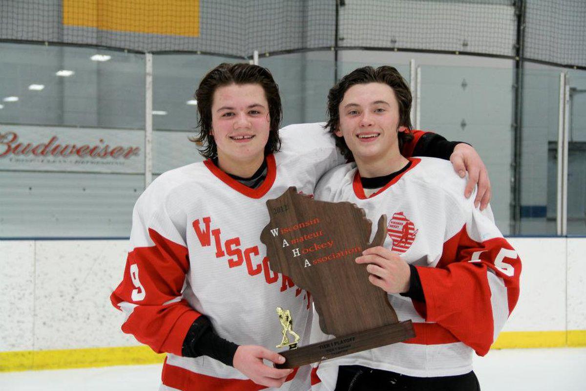 Tarek Baker and Sam McCormick celebrate a 2012 Team Wisconsin state championship.