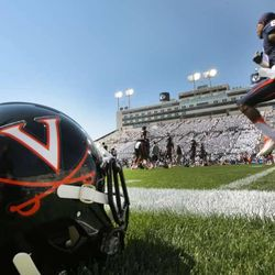 Virginia players warm up as they get ready for BYU Saturday, Sept. 20, 2014, at LaVell Edwards Stadium in Provo.