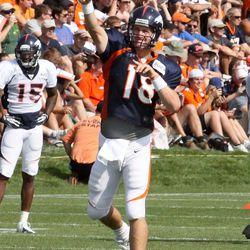 Peyton throws during the third day of training camp
