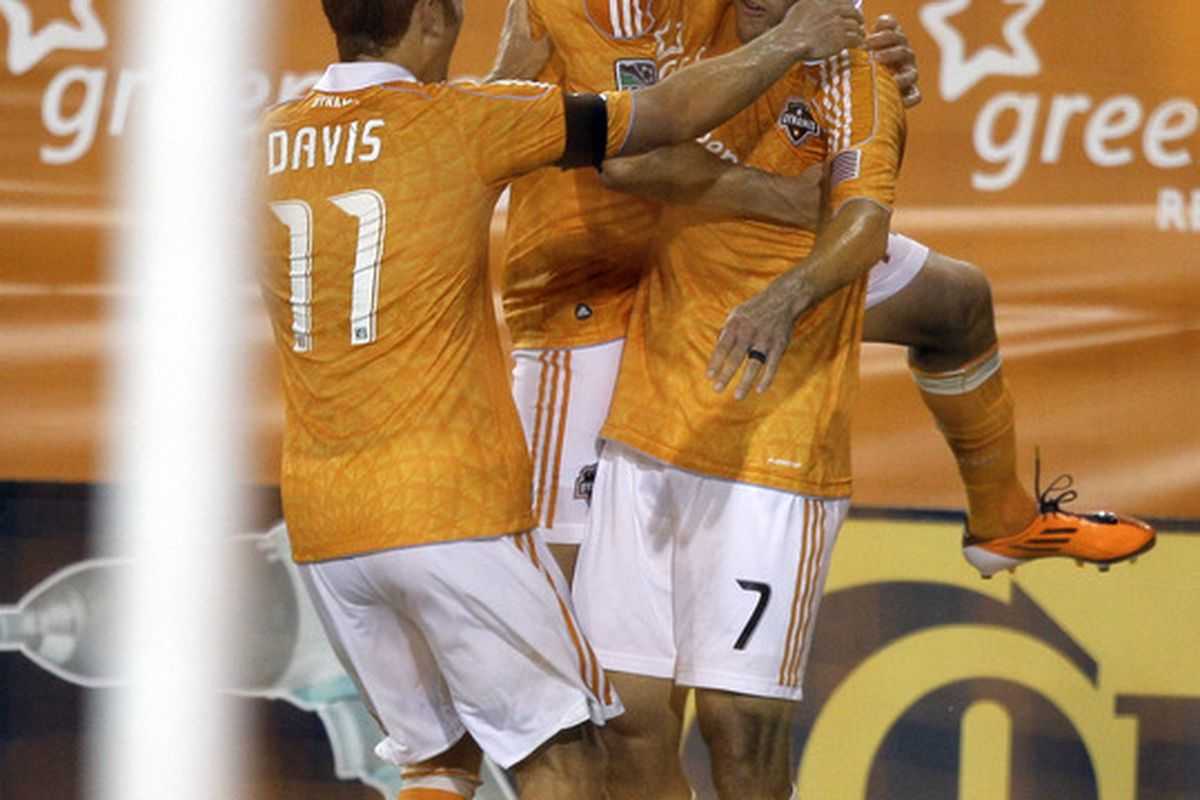 HOUSTON - MAY 28: Colin Clark #7 of the Houston Dynamo is congratulated by Brad Davis #11 and Mike Chabala #17 after scoring in the second half at Robertson Stadium on May 28, 2011 in Houston, Texas. (Photo by Bob Levey/Getty Images)