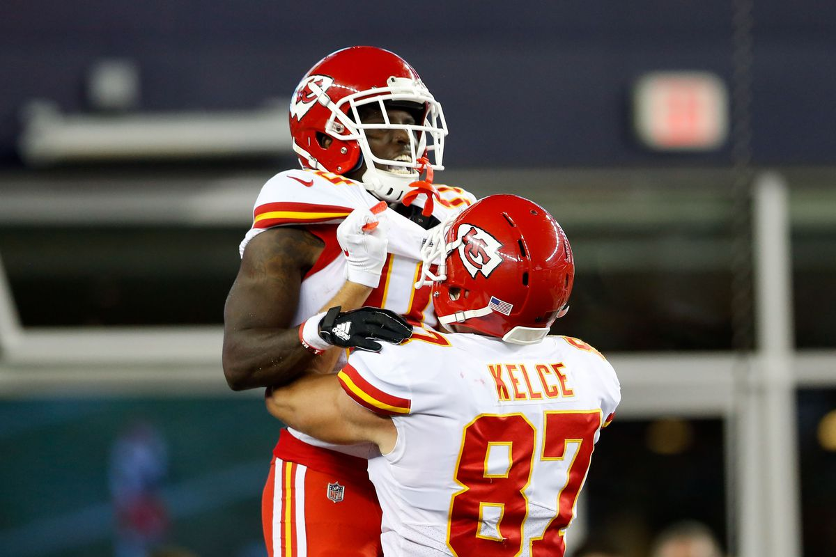 Kansas City Chiefs wide receiver Tyreek Hill celebrates with tight end Travis Kelce after scoring a touchdown against the New England Patriots at Gillette Stadium.