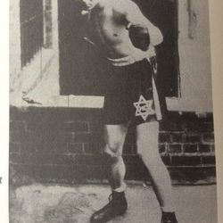 A teenage Mickey in blue satin boxing shorts with the Star of David.