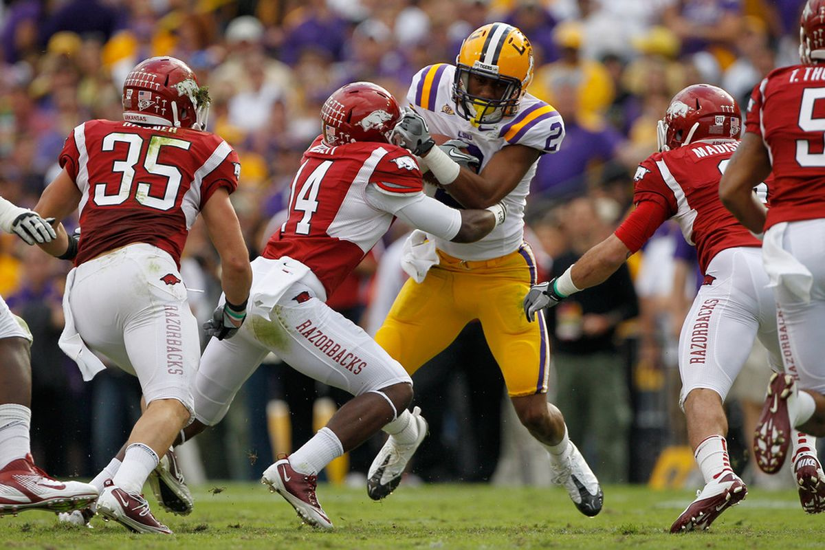 Wide receiver Rueben Randle #2 of the LSU Tigers is tackled by safety Eric Bennett #14 of the Arkansas Razorbacks.  (Photo by Chris Graythen/Getty Images)