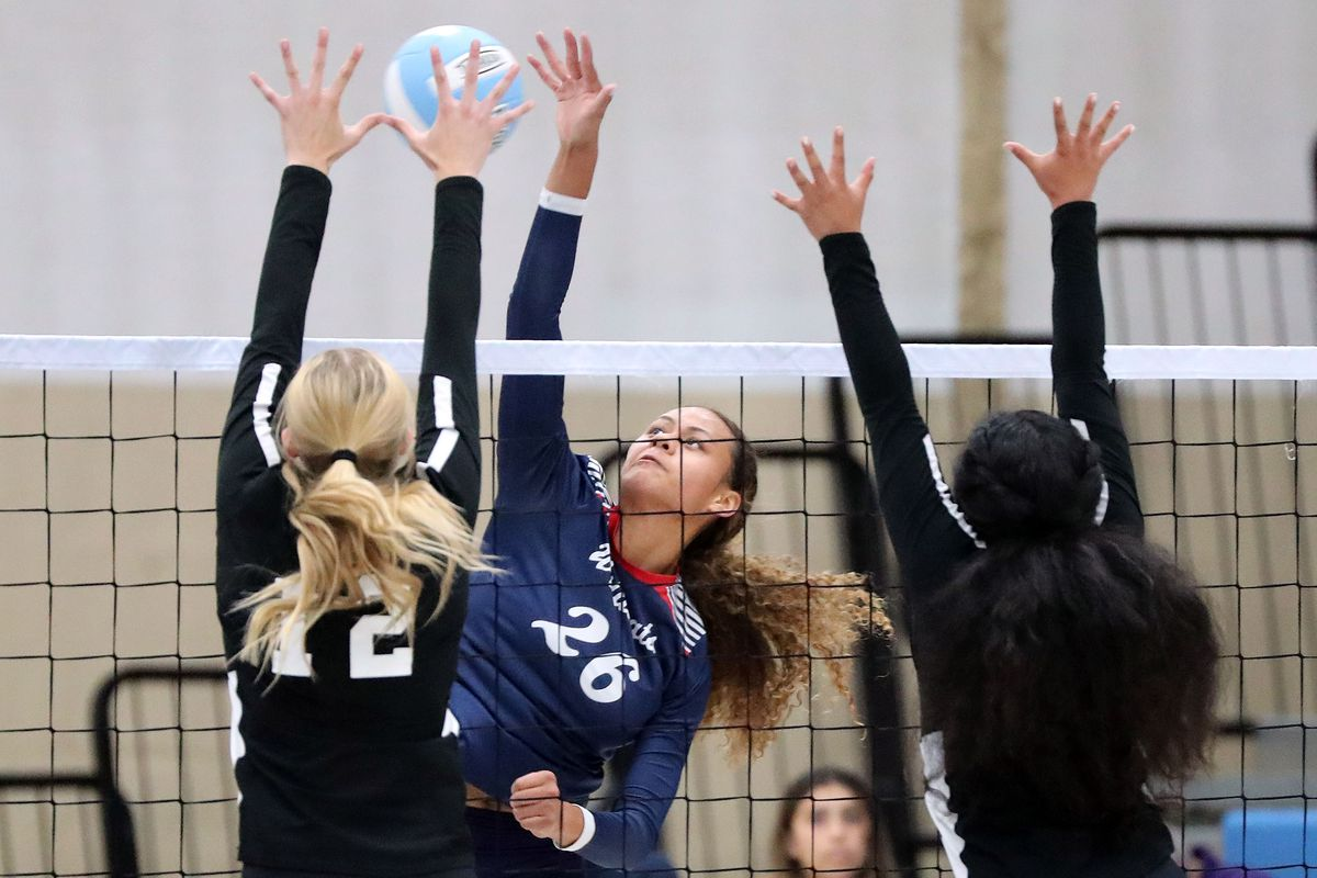 Woods Cross' Saane Katoa hits the ball during a volleyball game against West Jordan.