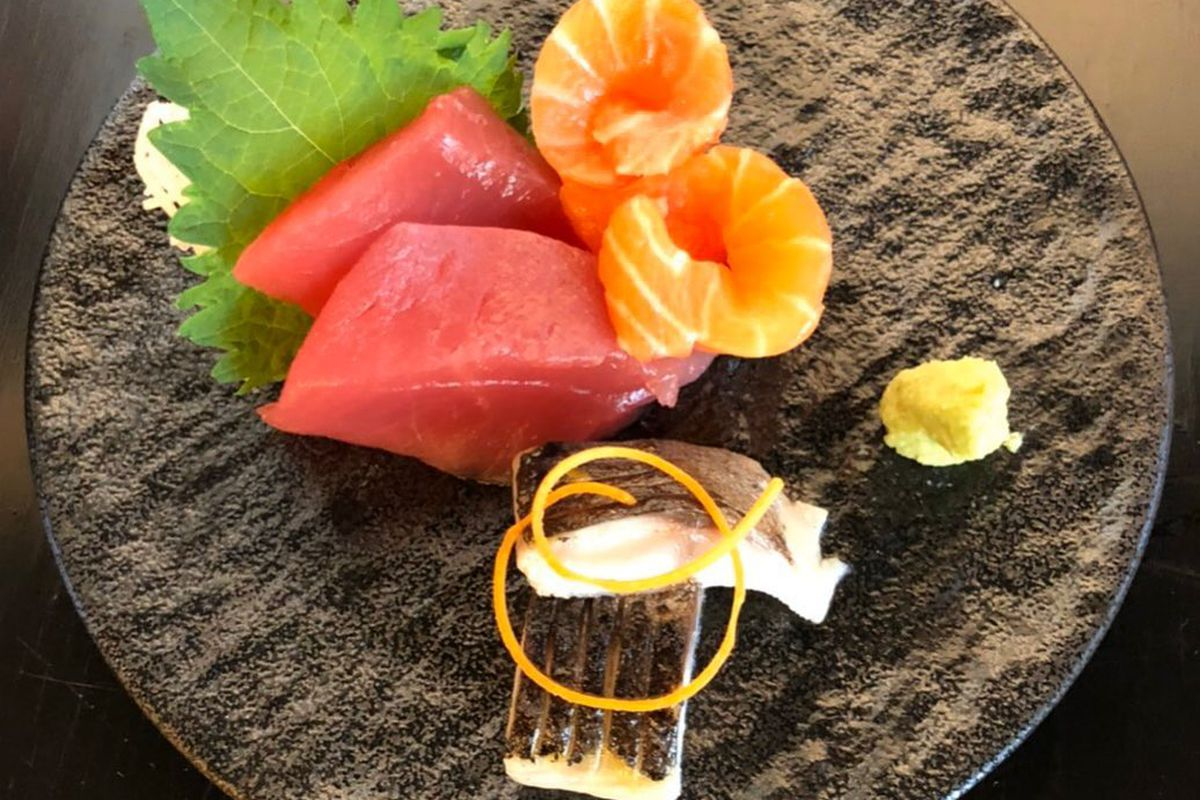 Tuna and salmon on a brown plate