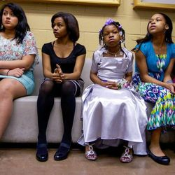 Alexis Atkins, far right, waits in the lobby of the Richmond City Jail for the father-daughter dance to start.