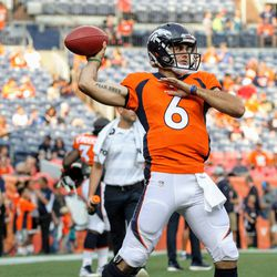 Current backup QB for the Broncos Chad Kelly reaches back to pass during pregame warmups.