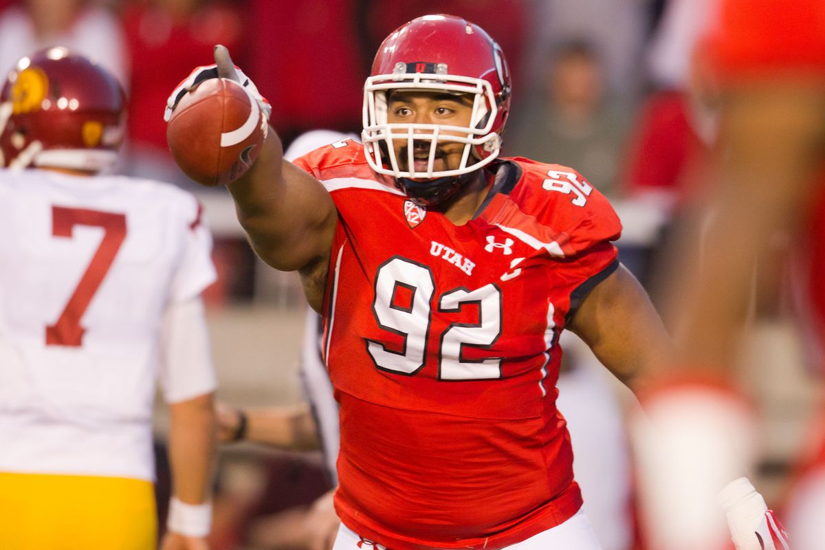 October 4, 2012; Salt Lake City, UT, USA; Utah Utes defensive tackle Star Lotulelei (92) celebrates a fumble recovery during the first quarter against the Southern California Trojans at Rice-Eccles Stadium.