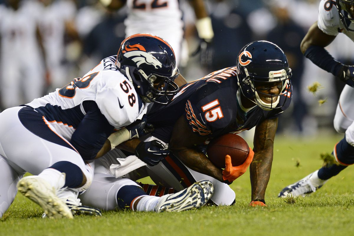 Aug 09, 2012; Chicago, IL, USA;  Chicago Bears wide receiver Brandon Marshall (15) makes a catch against Denver Broncos linebacker Von Miller (58) during the second quarter at Soldier Field. Mandatory Credit: Mike DiNovo-US PRESSWIRE