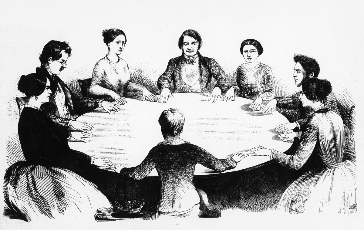 A depiction of a seance, circa 1860. (Ullstein Bild/Getty Images)