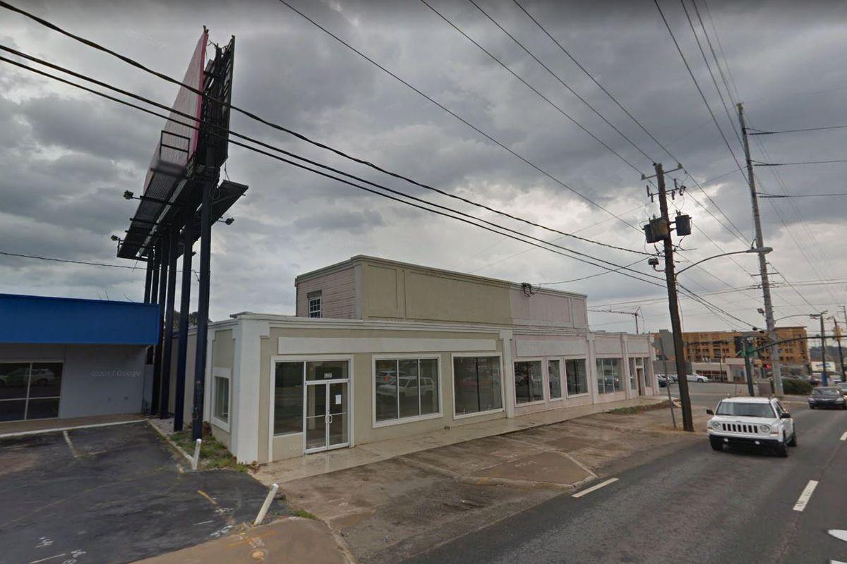 <br><br>A non-descript beige one-story commercial building.