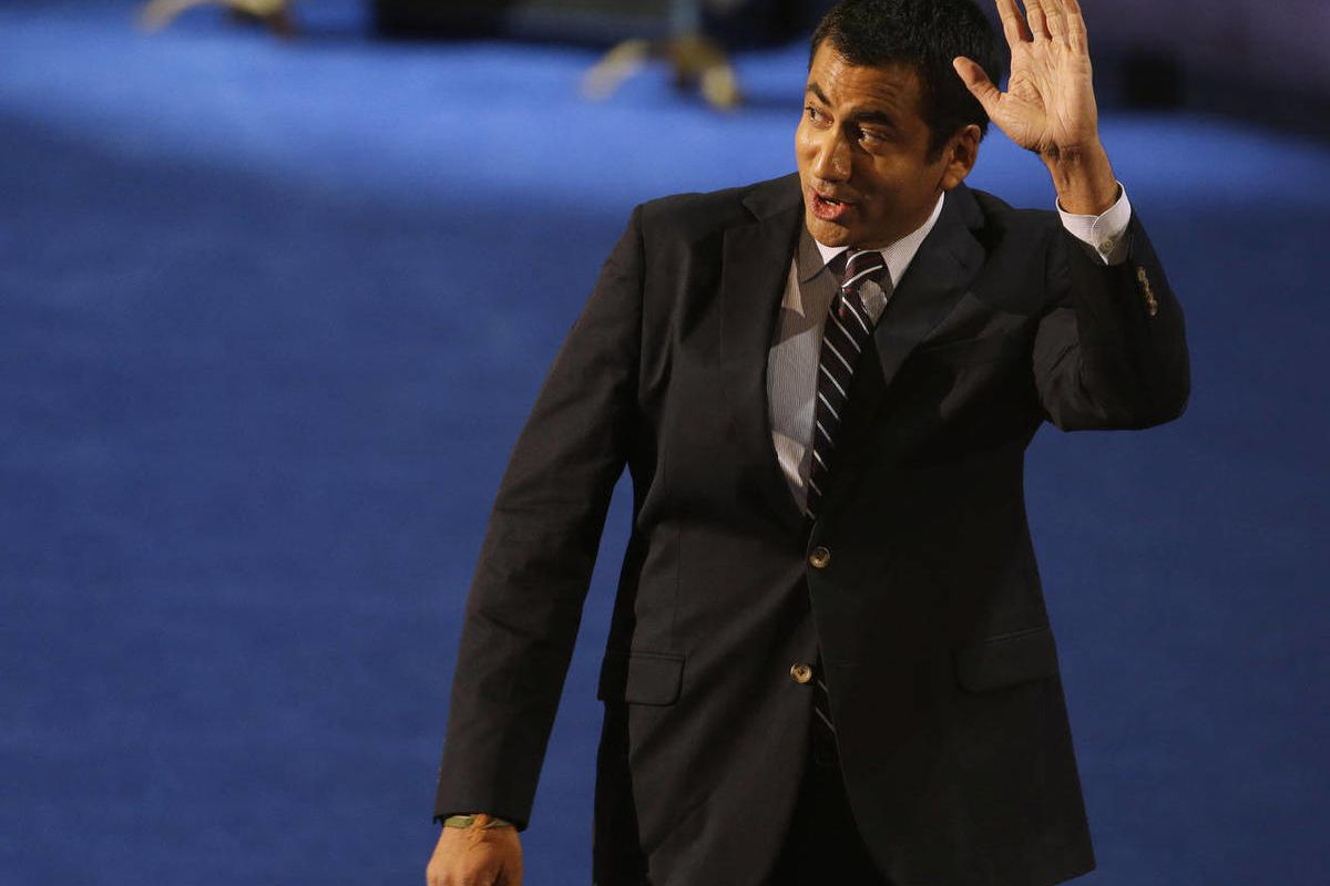 Actor Kal Penn waves after speaking at the Democratic National Convention in Charlotte, N.C., on Tuesday, Sept. 4, 2012.