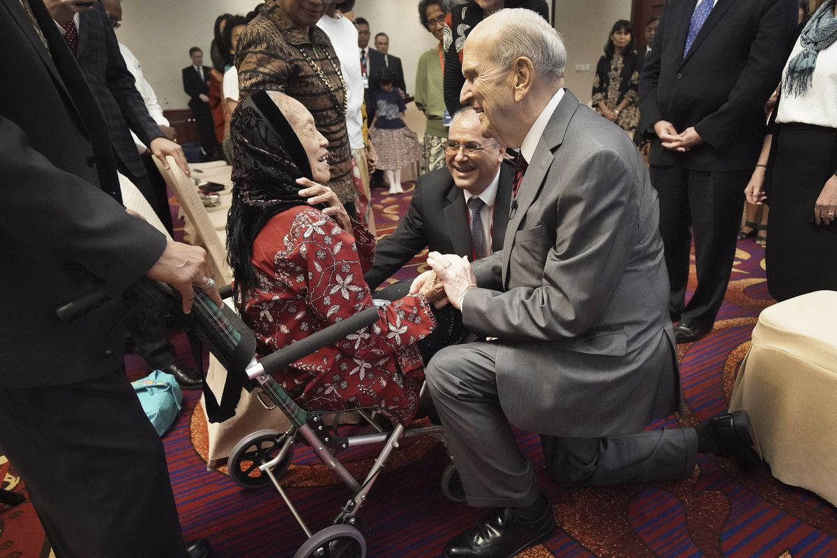 President Russell M. Nelson of The Church of Jesus Christ of Latter-day Saints talks with 86-year-old Tumini as he meets with multigenerational families in Jakarta, Indonesia, on Nov. 21, 2019.