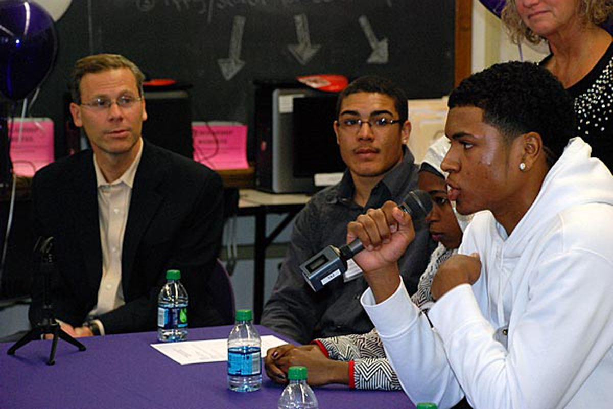DPS Superintendent Tom Boasberg looks on as students at South High School discuss their school's jump in 2013 graduation rate.