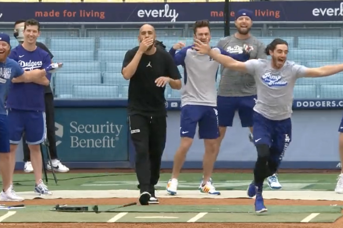 Cody Bellinger celebrates after hitting a golf ball closest to the pin to claim the #1 pick in the Dodgers fantasy football draft.