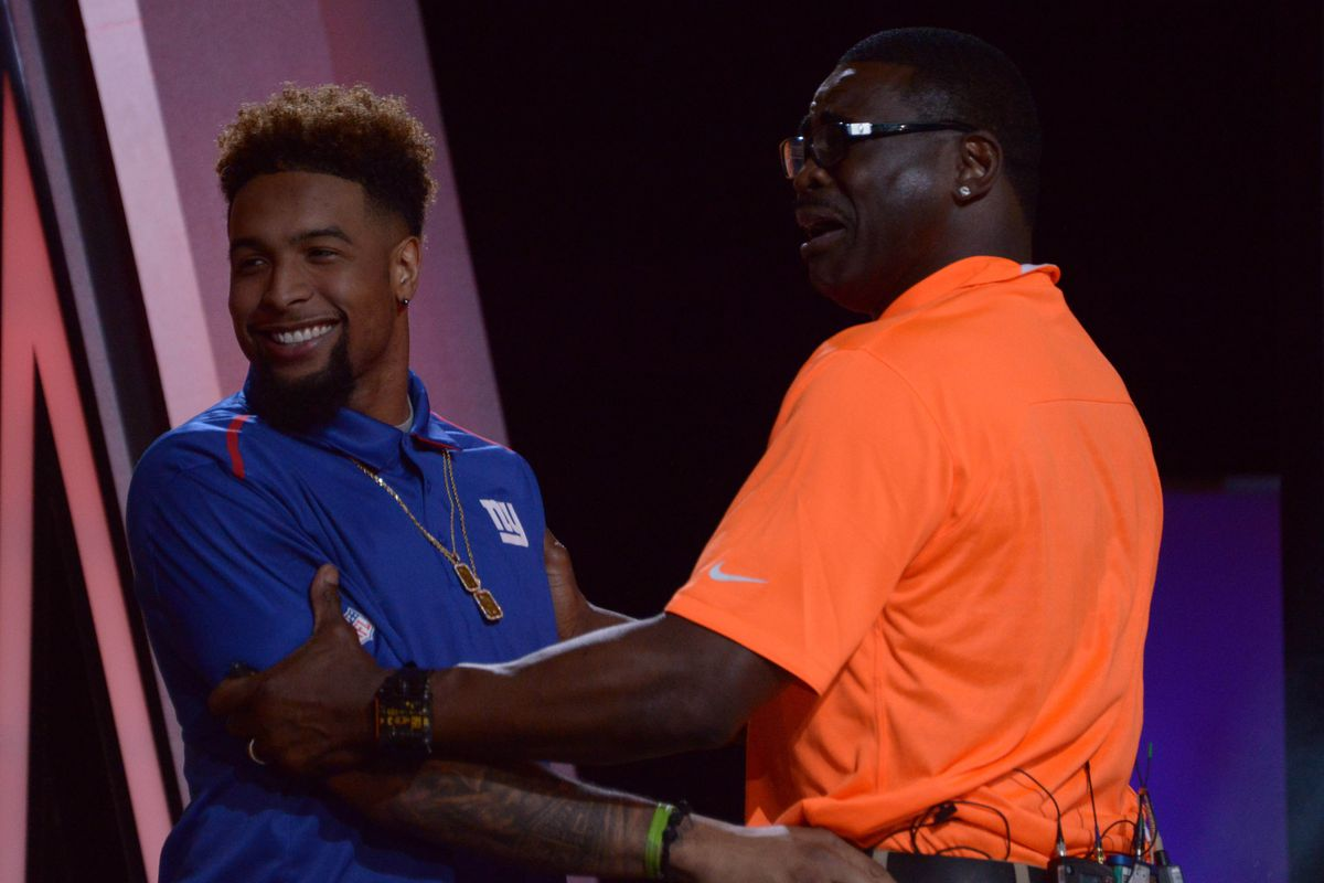Odell Beckham shakes hands with Michael Irvin after Irvin made him the fourth overall pick in the Pro Bowl draft on Wednesday.