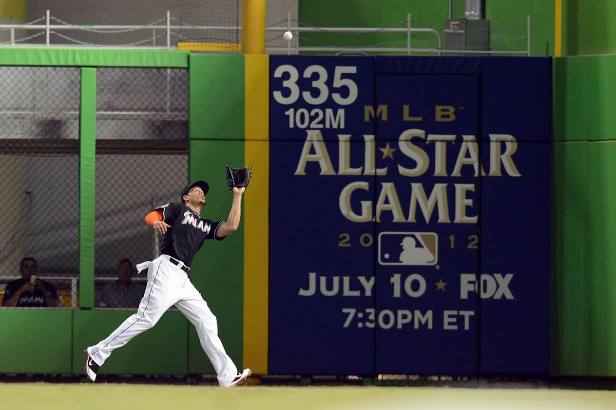 June 29, 2012; Miami, FL, USA; Miami Marlins right fielder Giancarlo Stanton (27) makes a catch during the second inning against the Philadelphia Phillies at Marlins Park. Mandatory Credit: Steve Mitchell-US PRESSWIRE