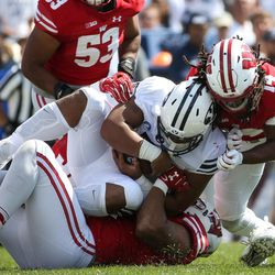 Brigham Young Cougars running back Ula Tolutau (5) is stopped by Wisconsin Badgers defense during the game at LaVell Edwards Stadium in Provo on Saturday, Sept. 16, 2017.